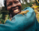 Nancy Rono, Farmer, on her farm with cameleonon on her arm. Bomet County, Mara River Upper Catchment, Kenya.